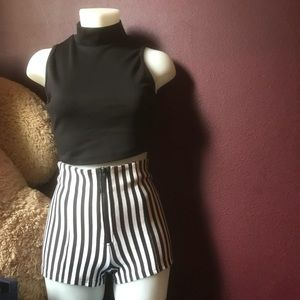Crop black shirt and black/white shorts.